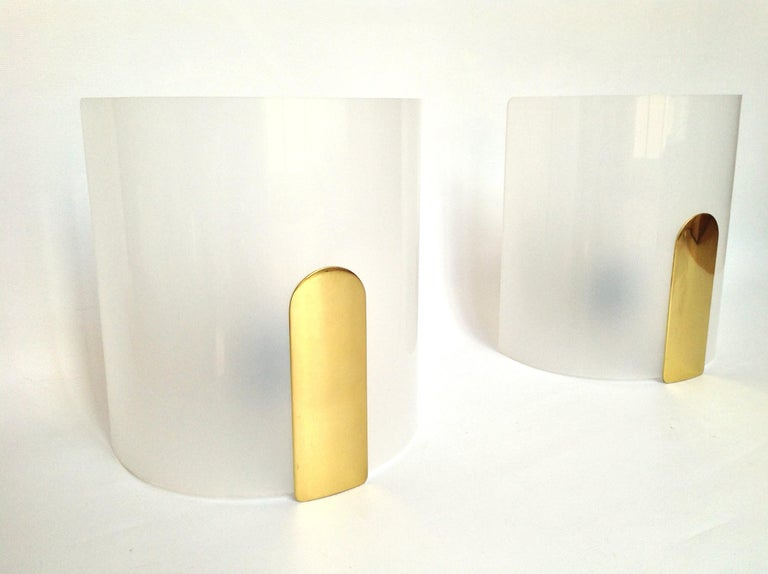 Chic and beautiful pair of midcentury Lucite and brass wall sconces.