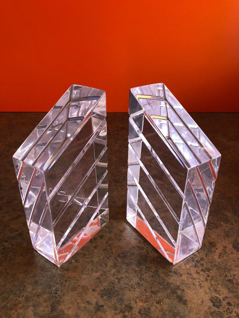 A gorgeous air of midcentury Lucite bookends by Astrolite, circa 1960s. The pair are in excellent condition and would make a great addition to any midcentury study or library!