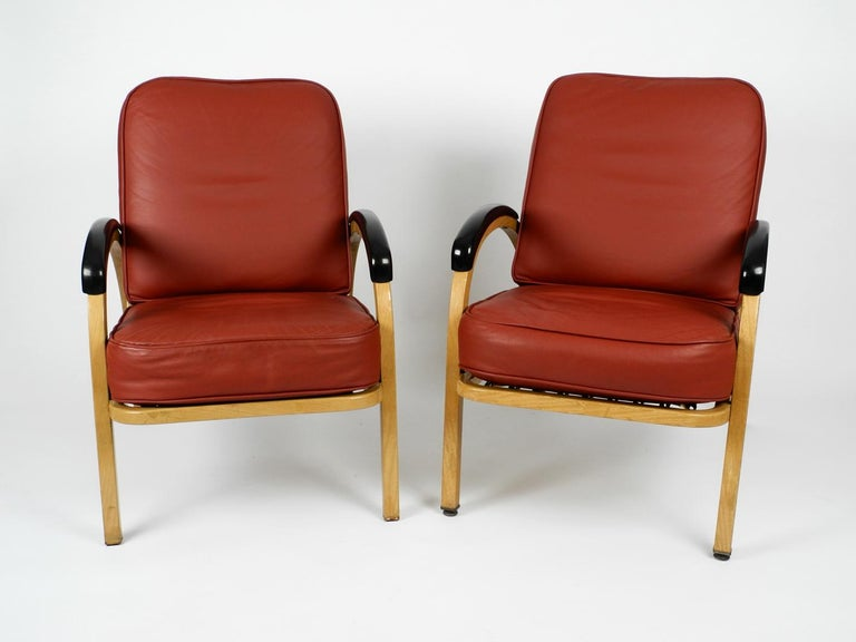 Pair of beautiful very rare Mid-Century Modern armchairs from the 1940s. Beautiful design. Design Norman Bel Geddes, produced by Simmons Company. Made in USA. Frame made of square steel tubes, still in original beige color. Seat and back were