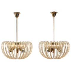Pair of Midcentury Partly Gilded, Brass and Crystal Venini Style Chandeliers