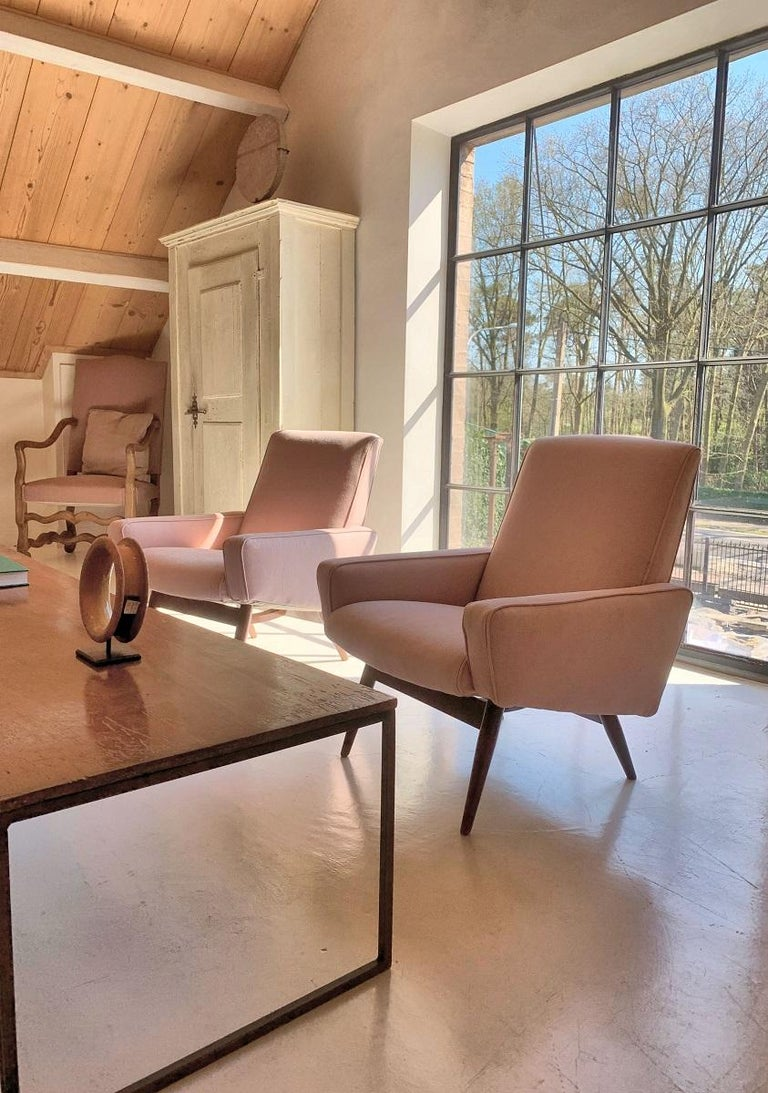 A pair of midcentury English lounge chairs. Beech frames with new pink linen upholstery.