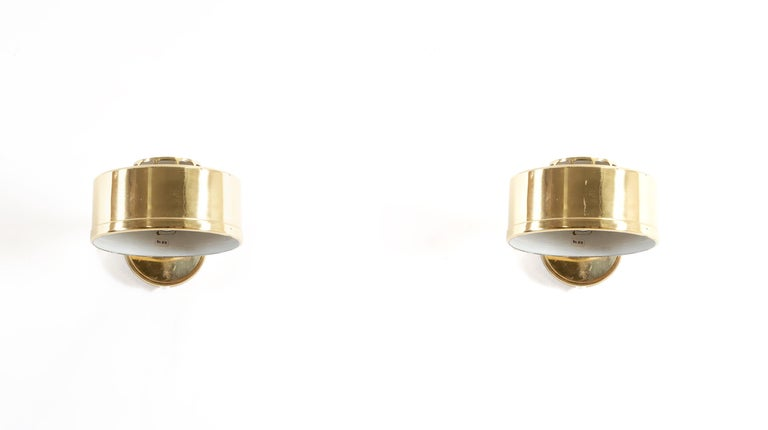 Sublime pair of wall lights in brass. Designed and made in Sweden from circa 1970s first half. Both lamps are in good vintage condition and fully working. Max 60W.