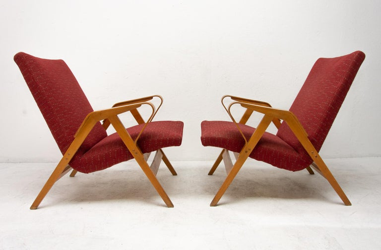 These Czechoslovak lounge armchairs were designed by František Jirák for Tatra Nabytok in the former Czechoslovakia in the 1960s. The design of these chairs followed the huge success of the Czechoslovak pavilion at the Brussels Expo 58. The