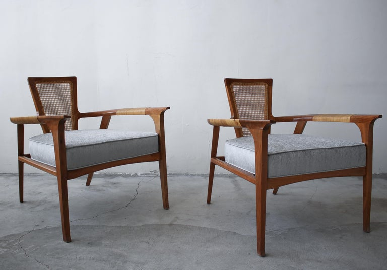 This extremely rare and sculptural pair of midcentury lounge chairs was designed by William Hinn for The Urban Furniture Company, Swedish Guild Collection. If you've been looking for a gorgeous pair of statement chairs with the most amazing details