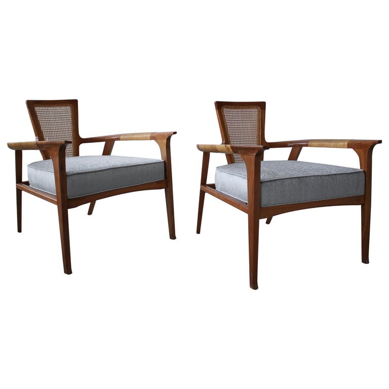 Pair of Midcentury Walnut and Cane Lounge Chairs by William Hinn For Sale