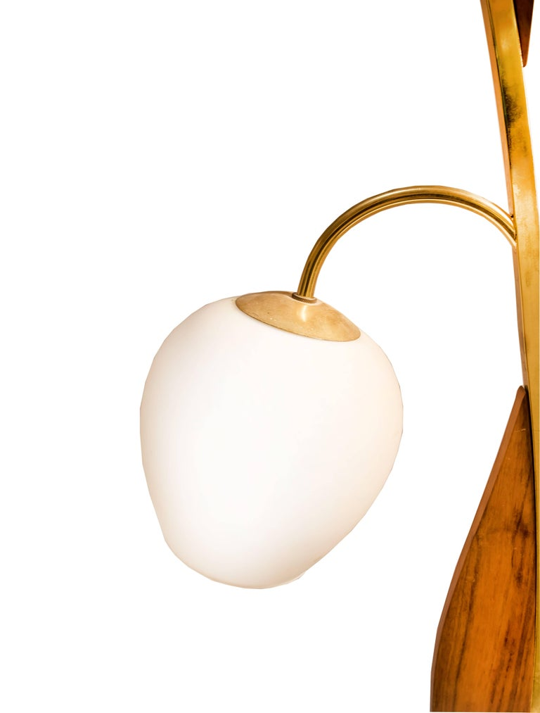Pair of midcentury wood and brass tulip shape two-light table lamps probably Italian.