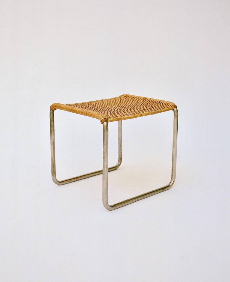 A pair of nickel-plated tubular metal stools with woven rattan seats designed by Ludwig Mies van der Rohe and Lilly Reich, manufactured by either Berliner Metallgewerbe Josef Müller or Bamberg Metallwerkstatten, circa 1927. This design appears in