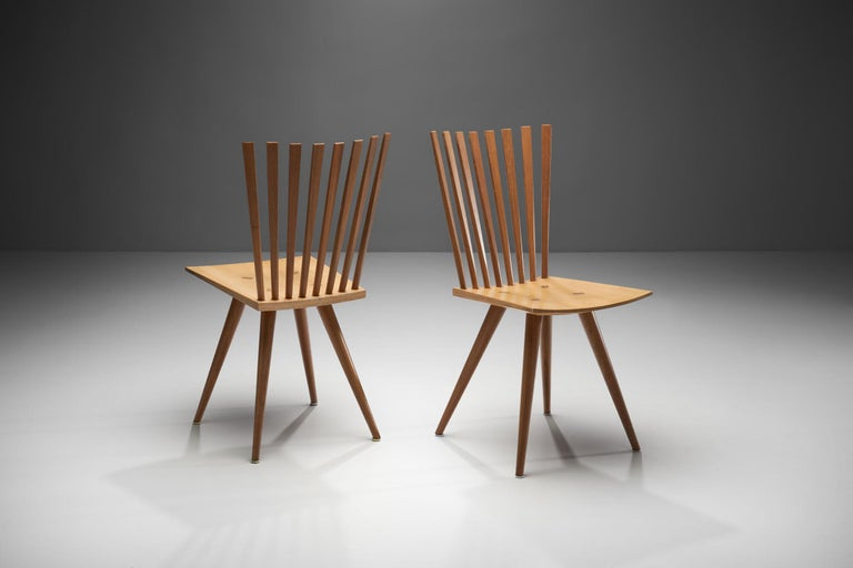 """This pair of model J152 chairs by the Danish designer duo, Johannes Foersom and Peter Hiort-Lorenzen, is better known as the """"Mikado"""" chair.  The Mikado is a modern interpretation of the 18th century English Windsor chair, whereby the chairs are"""