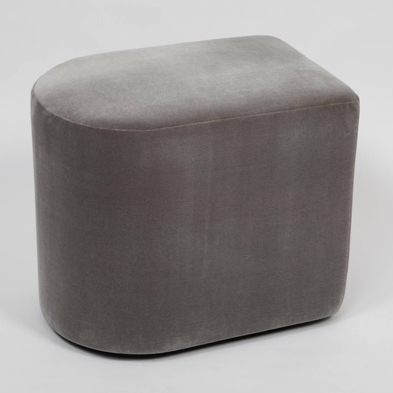 Unusual, rounded 1980s Milo Baughman stools on recessed casters. Newly reupholstered in smokey-gray cotton velvet. Signed