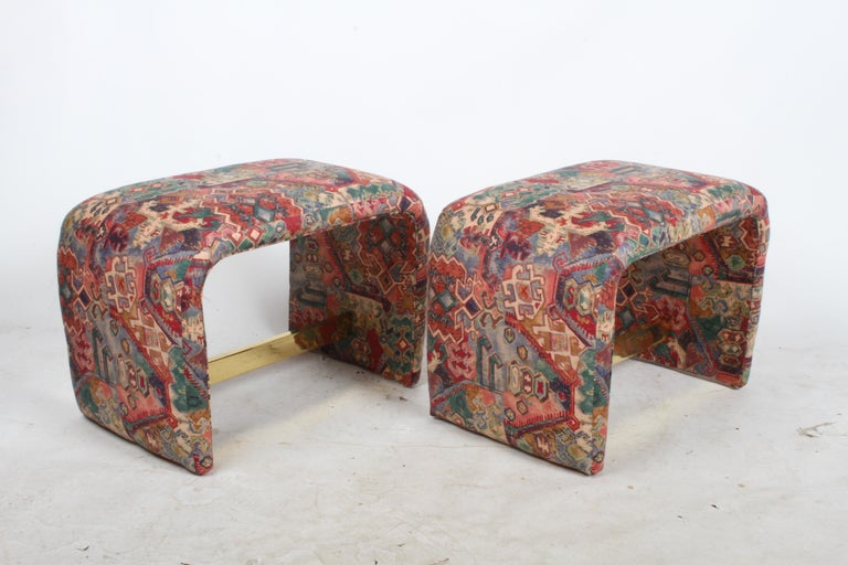 Milo Baughman for Thayer Coggin waterfall design ottomans, vanity benches or stoosl with brass stretcher. Original designed in the late 1970s, the production date on these date to the mid-1980s, retains original labels. The single one shown with