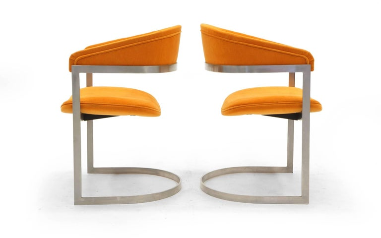 Pair of Milo Baughman for Thayer Coggin side chairs. Brushed steel frames and orange Maharam fabric. Expertly restored.