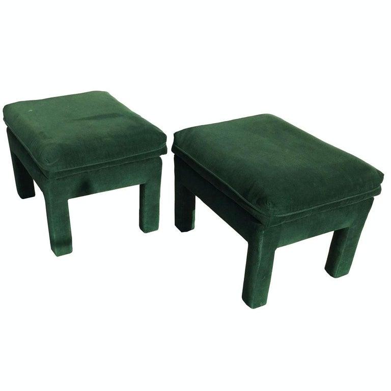 A pair of Milo Baughman parsons style pillow top ottoman in a rich green velvet.