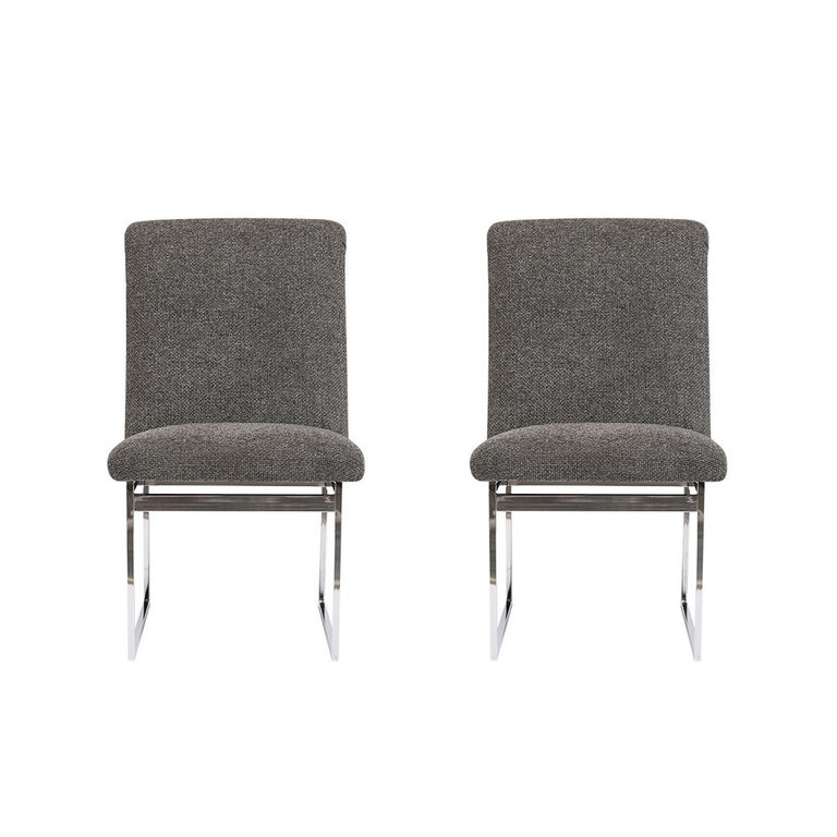 An extraordinary pair of 1960s midcentury chrome side chairs in the style of Milo Baughman. The set of chairs features sleek chrome frames in a very good condition and has been professionally reupholstered in dark gray color fabric with new foam