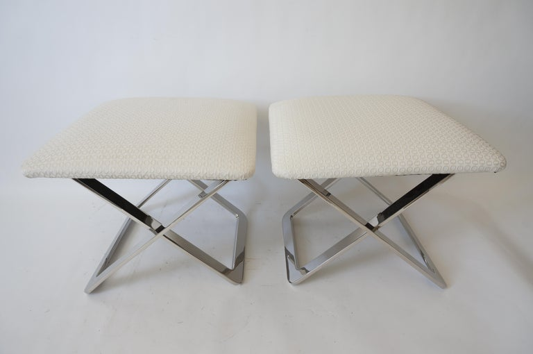 This stylish and chic pair of x-form stools are very much in the style of Milo Baughman's flat bar collection.  Note: The pieces have been professionaly upholstered in a woven fabric.