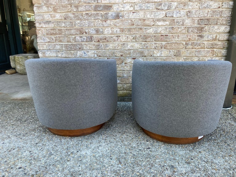 Newly reupholstered and restored pair of Milo Baughman swivel chairs..... gray wool flannel.