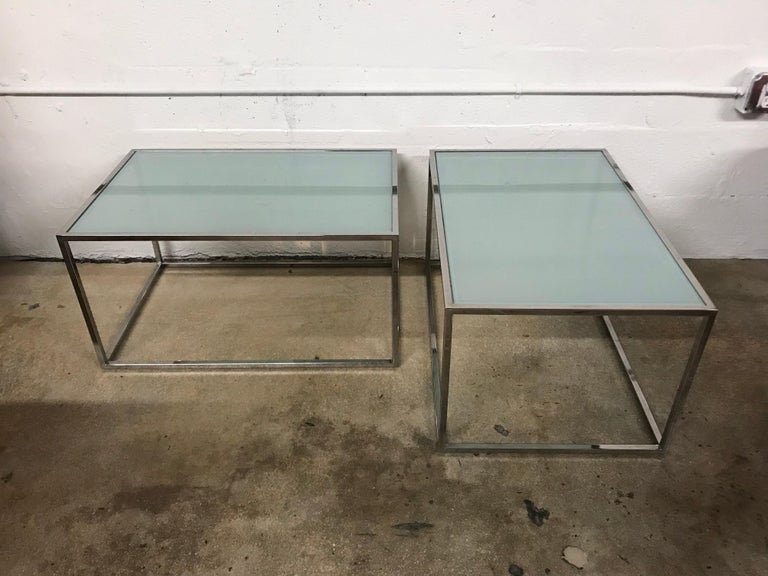 Set of two Thinline coffee cocktail side or end tables by Mid Baughman rendered in chrome-plated steel with frosted glass tops, can be configured in multiple ways to be used as a coffee table grouping or separate for flanking side or end tables.