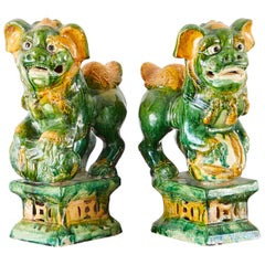 Pair of Ming Style Glazed Foo Dogs on Stands
