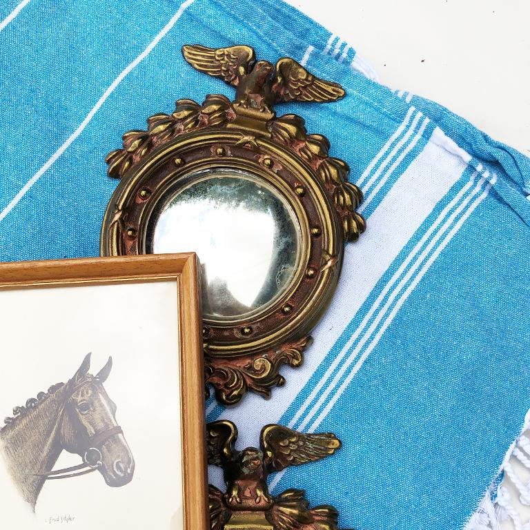 Two round convex admiral eagle brass mirrors are known as bull's-eye or porthole mirrors. A patriotic addition for lovers of the Federal period or Victorian period. Made of cast iron brass or bronze or wrought iron, each mirror is heavy and solid.