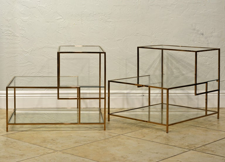 These end tables feature an elegant Minimalist design reminiscent of Piet Mondrian's art. The frames are made of solid brass with beautiful sleek craftsmanship. The three glass surface tiers offer great options for placement of lamps, magazines and