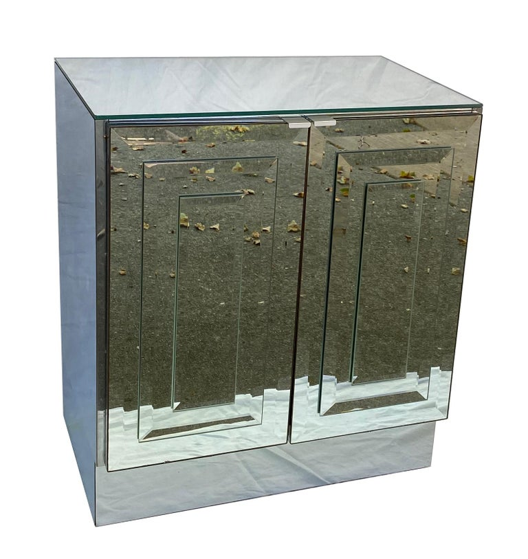 Dramatic pair of mirror and stainless steel clad cabinets or nightstands by Ello Furniture. The bases and sides are clad in polished stainless steel and the doors and top are done in 1/4