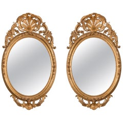 Pair of Mirrors in Carved and Guilt wood. French, 19th century