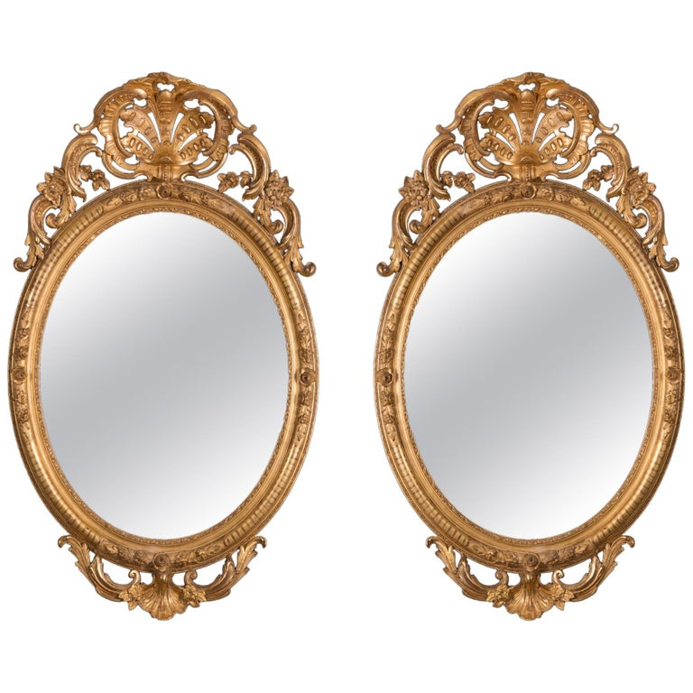 Pair of Mirrors in Carved and Guilt wood. French, 19th century  For Sale