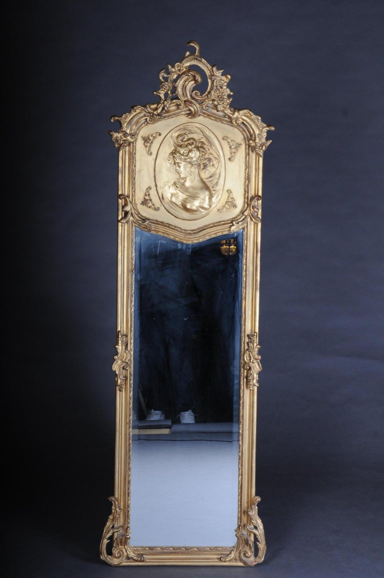 Pair of mirrors or wall mirror in Louis XV / Baroque style  Solid wood, gilded. High rectangular profiled mirror frame. Gable box with plastic crowning of medallion-shaped cartridges and plastic rocaille crowning. Centred mirror glass. Beautiful