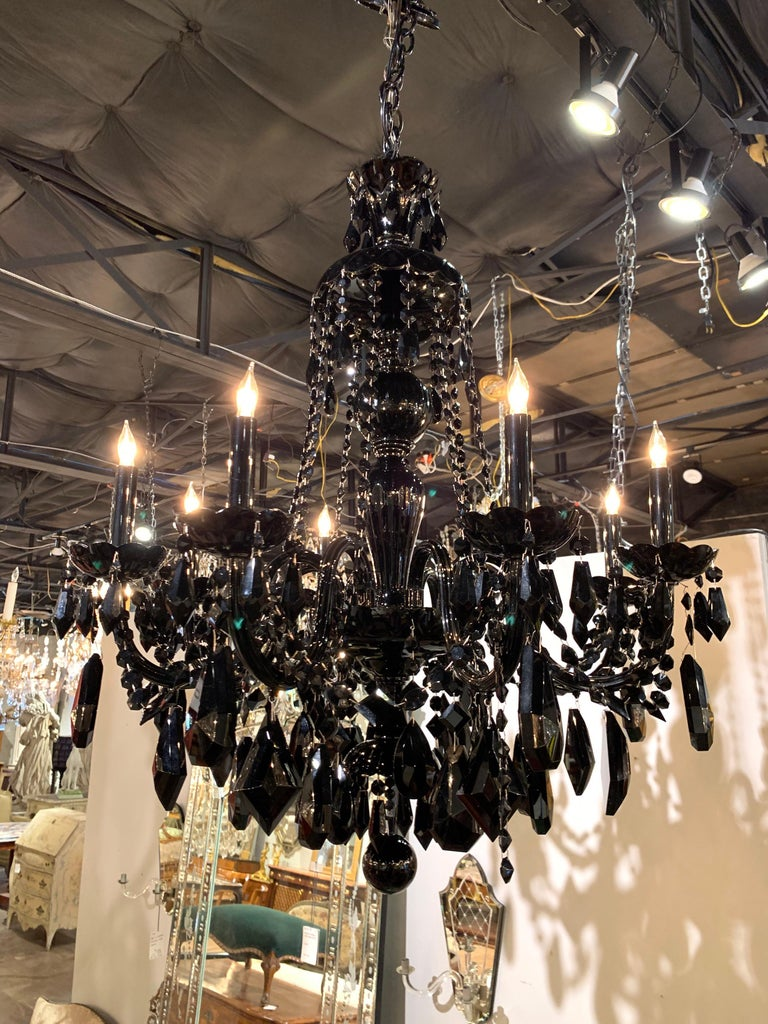 Very striking modern pair of black crystal chandeliers with 8-light. Large array of glistening beads and crystals. This unique pair would be wonderful for an upscale design!
