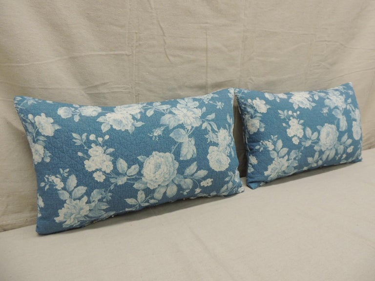 Pair of modern blue and white quilted cotton floral decorative lumbar pillows. Decorative pillow handcrafted and designed in the USA. Closure by stitch (no zipper closure) with custom-made pillow insert. Size: 12
