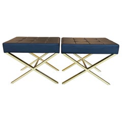 O Pair of Modern Brass and Black Pillow Ottomans