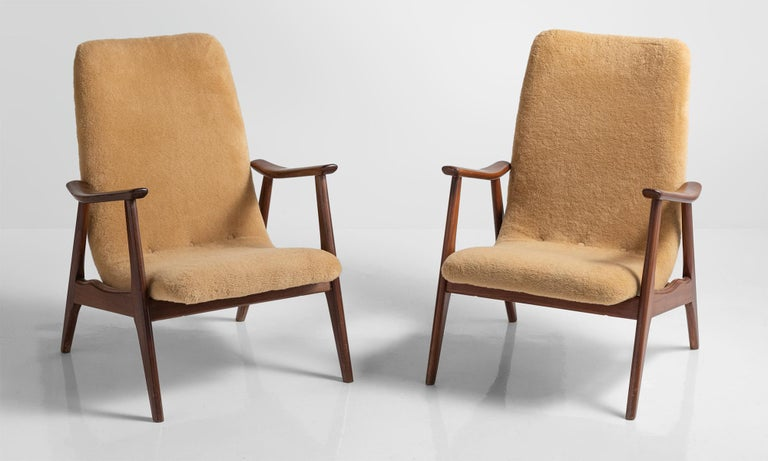 Pair of modern faux wool armchairs, Sweden, circa 1950.  Pair of Scandinavian forms with teak frame and original faux wool upholstery.