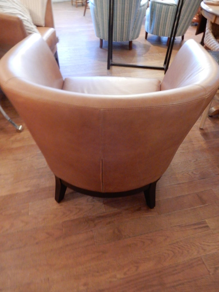 Fabulous pair of Italian top quality leather arm chairs or club chairs. Cognac brown soft leather in excellent condition. Walnut wood feet, generous seat extra large.