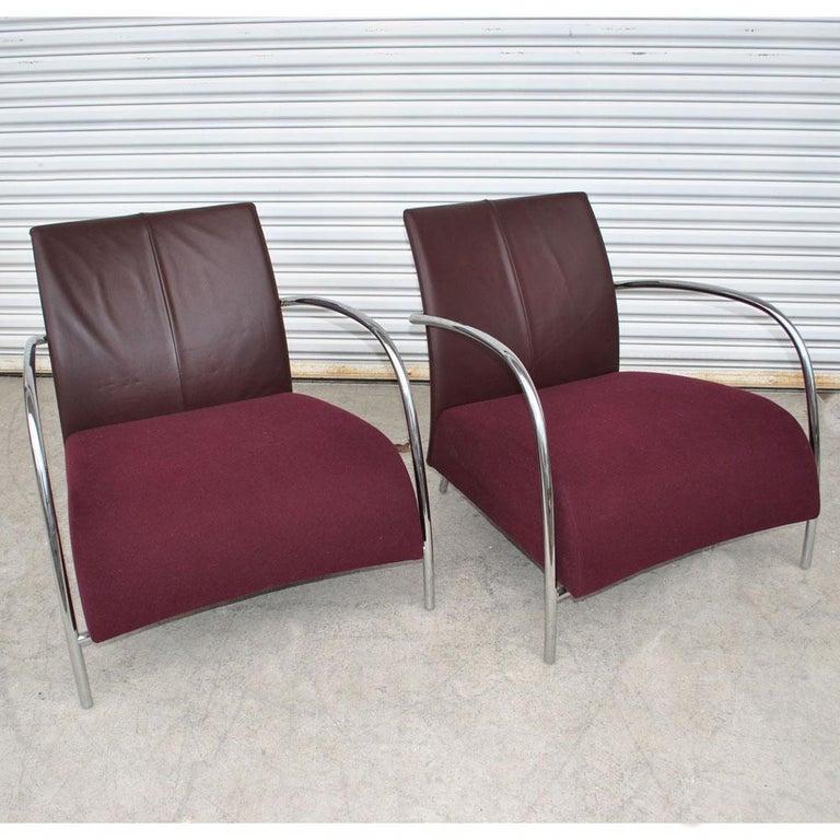 Pair of modern Italian style tubular chrome lounge chairs.    Pair of beautiful modern Italian style chrome tubular chairs. Zippered leather backs with raspberry mohair seats.