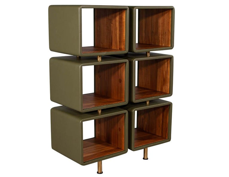 """Pair of modern leather Clad bookcases. Olive leather clad bookshelves with teak interior and satin brass accents.  Price includes complimentary curb side delivery to the continental USA.  Measurement of interior cube W: 17.5"""", H: 14"""", D:17.5""""."""