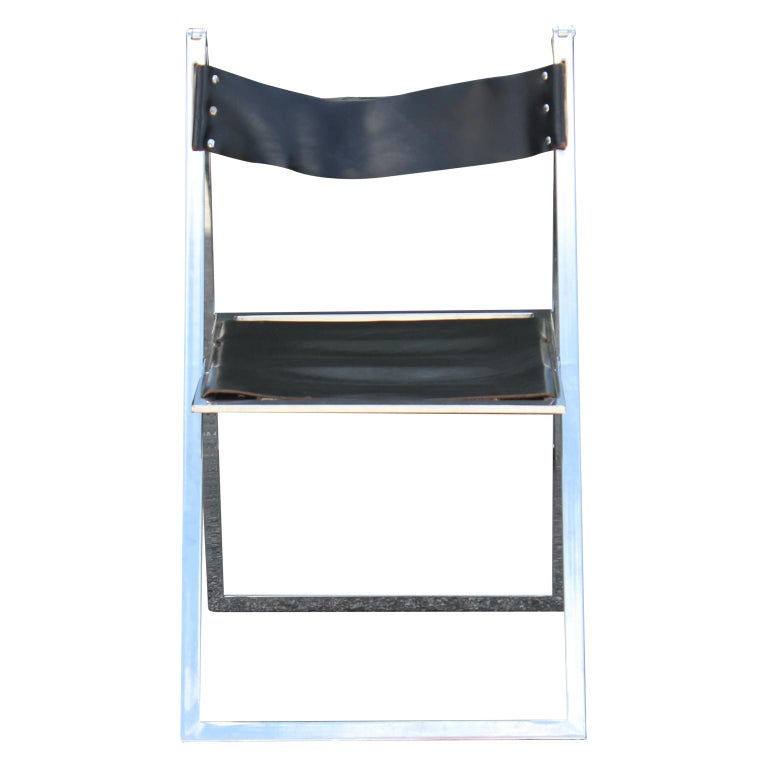 Pair of gorgeous black leather folding chairs by Lübke with a chrome