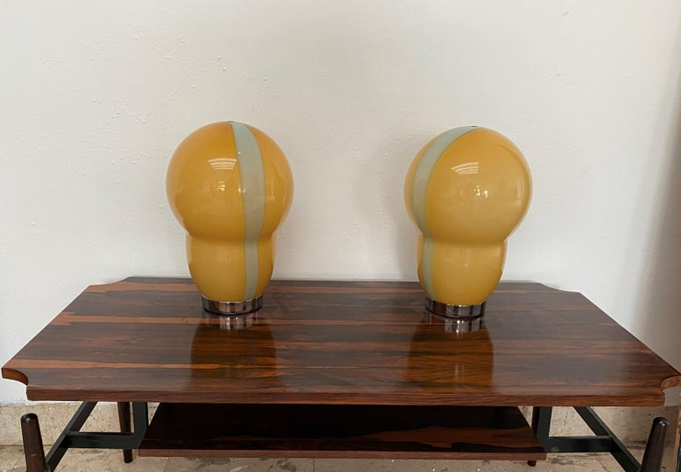 Beautiful  table lamps in orange and green hand-blown Murano glass. Designed by Ettore Sottsass for Venini and manufactured in 1994. The glass shade is signed