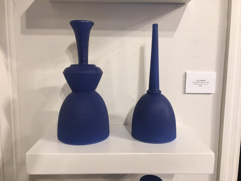 Pair of modern Pantone color fine ceramic objects of art by Yves Paquette on a floating shelf. L'hiver Blue Series of Two  Yves Paquette -