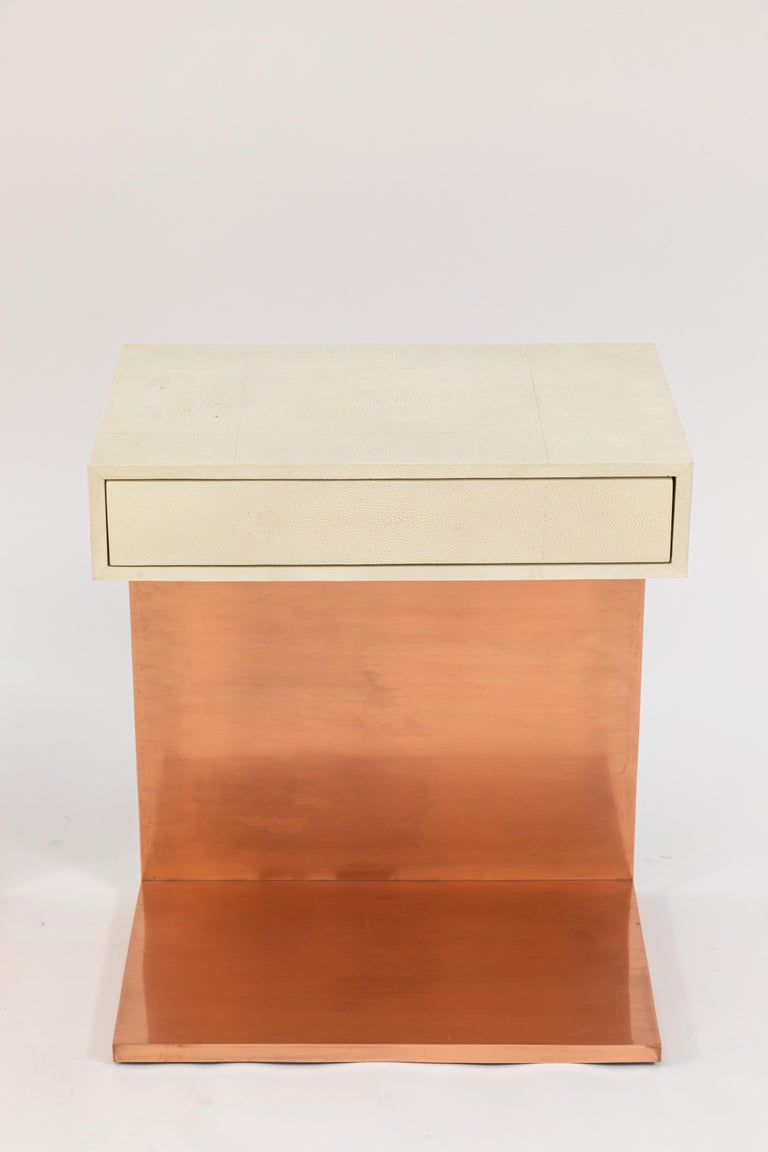 Pair of modern single drawer side tables with white shagreen tops and copper finish.