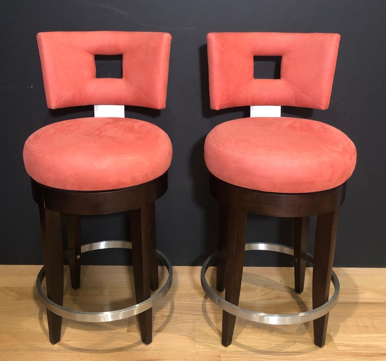 Pair of high back Odeon modern bar stools by Evanson Studios New York. Beautifully upholstered, swivel with foot rest in contrasting brushed stainless steel.
