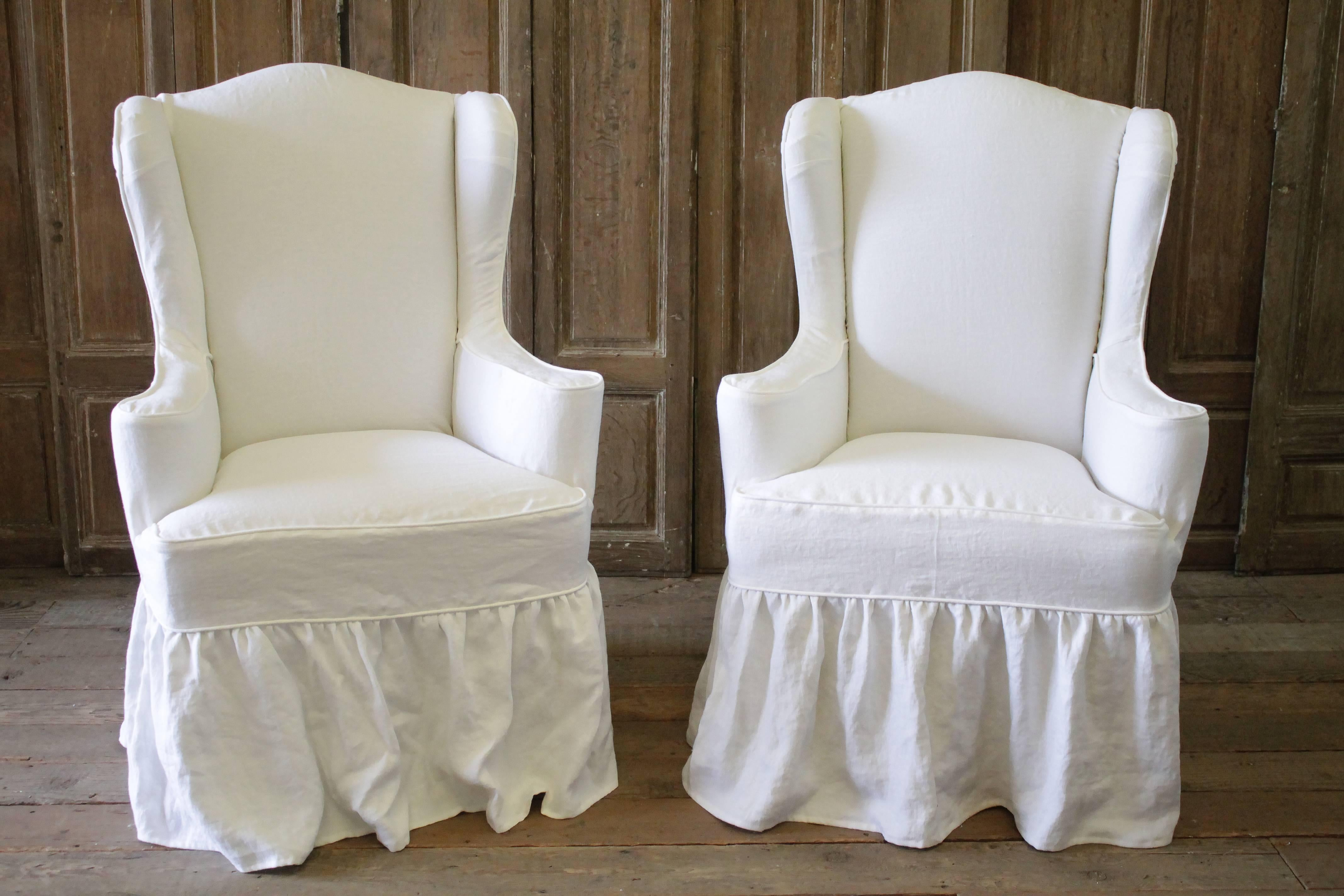 Pair Of Modern White Linen Slip Covered Wingback Chairs With Ruffle Skirt  These Modern Wing Chairs