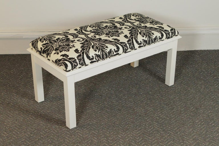 Pair of modern white painted wood upholstered benches.