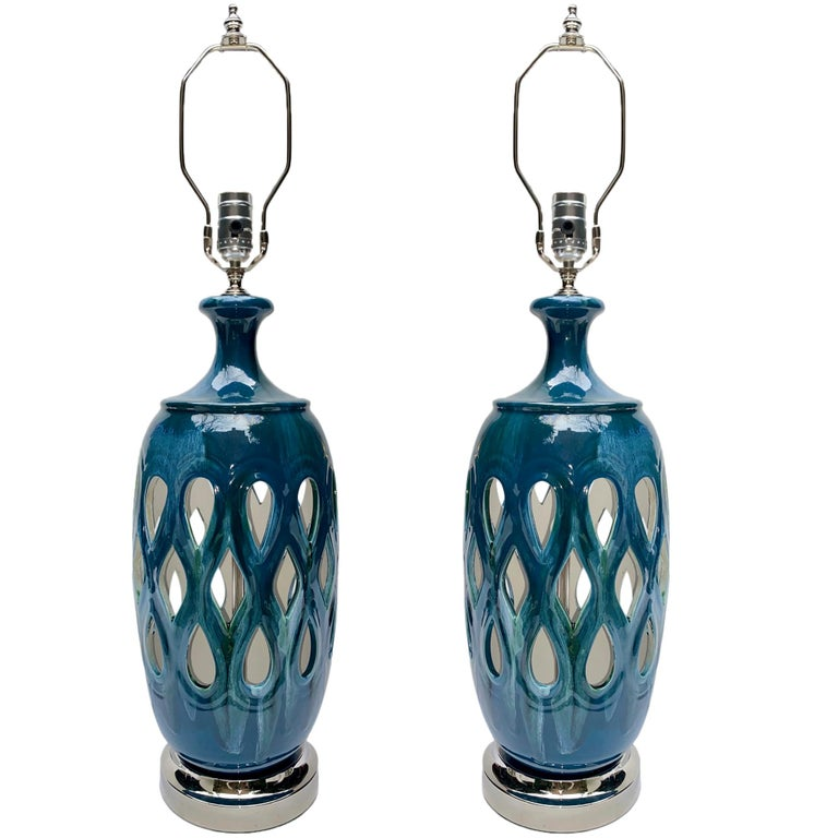 Pair of Italian 1950's blue porcelain lamps with silver plated bases.  Measurements: Height of body: 19