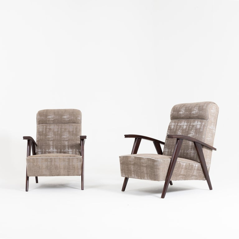Stained Pair of Modernist Armchairs Attributed to Jacques Adnet For Sale