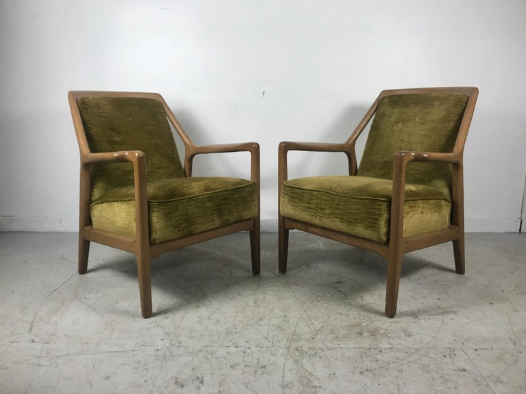 Handsome pair of Mid-Century Modern lounge club chairs by Jack Van der Molen for the Ash Group by Jamestown Lounge Company. They wear their original crushed velvet fabric and tobacco finish which are in amazing vintage condition. Extremely