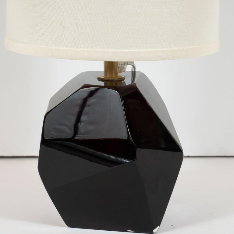 This stunning and elegant pair of table lamps were realized in Murano, Italy- the island off the coast of Venice renowned for centuries for its superlative glass production. They feature faceted bodies- like oversized cut gemstones- in a gorgeous