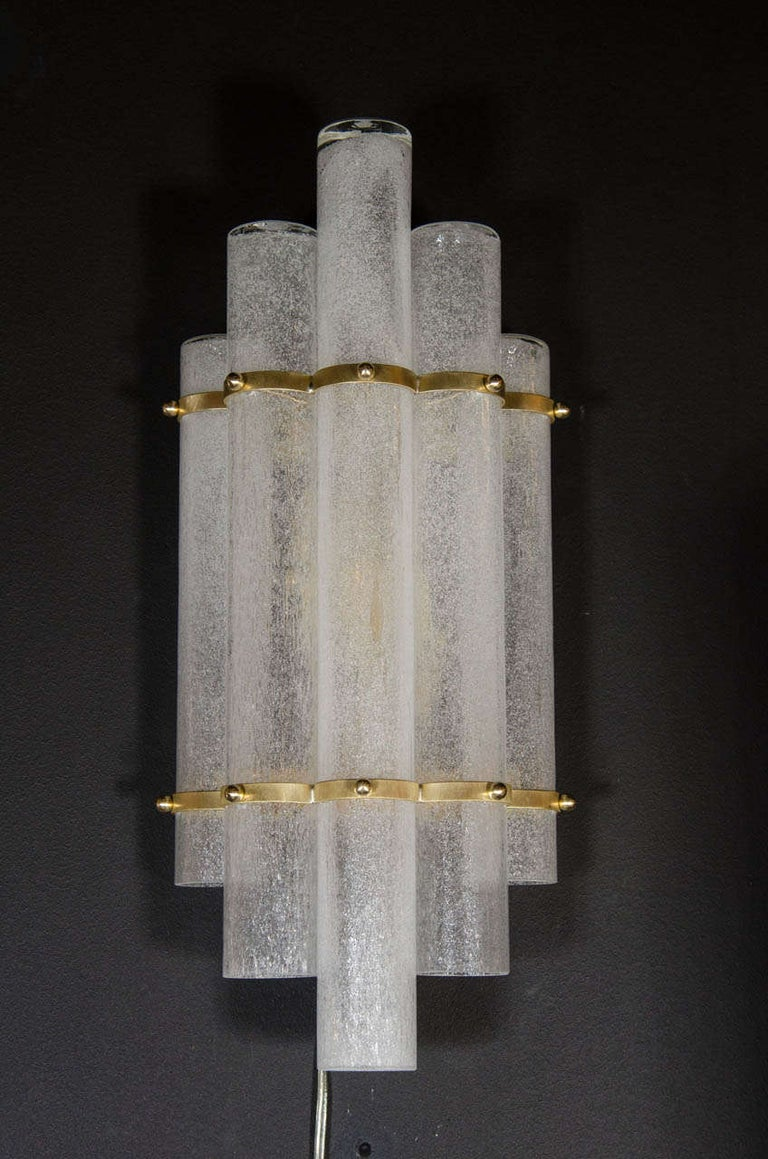 This stunning pair of sconces were hand blown in Murano, Italy- the island off the coast of Venice renowned for centuries for its superlative glass production. They feature five staggered tubular Pulegoso textured translucent glass shades secured