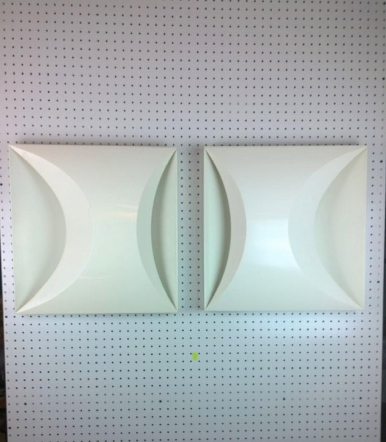 Offered are a pair of modernist later 20th century modern square white sconces by RAAK of Amsterdam. This pair can also be used a flush mount lighting. This truly mod pair almost look like the Couregges' logo. The pair would look fabulous on each