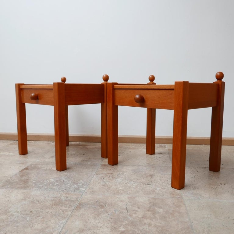 Pair of elegant bedside or side tables.  French, circa 1970s.  Stained pine.  Dimensions: 49 W x 39 D x 51 H in cm.