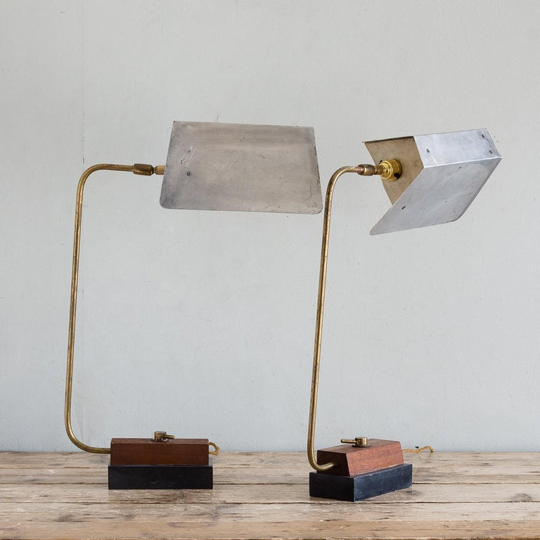Pair of modernist table lamps, circa 1960, sheet aluminium, brass, teak and slate, workshop made with adjustable arms. Re-wired and tested.