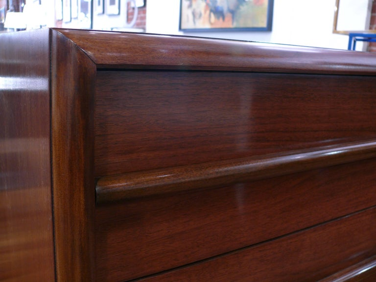 A pair of walnut three-drawer chests or dressers. Designed by T.H. Robsjohn-Gibbings for Widdicomb. Newly refinished walnut. Great Bedside or as dressers. Refinished and ready to use. With original label: Robsjohn-Gibbings for Widdicomb.